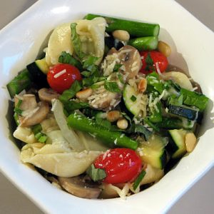 Pesto Tortellini with Sautéed Vegetables and Parmesan Cheese