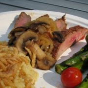 Camping Cuisine - Flank Steak with Caramelized Onions and Mushrooms alongside Asparagus and Tomatoes