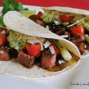 Steak, Anaheim Chile, and Scallion Tacos with Guacamole and Cotija Cheese