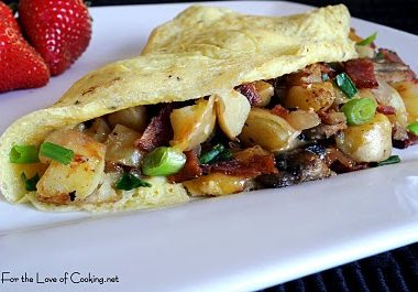 Peasant Omelet with Potatoes, Mushrooms, Bacon, and Cheddar