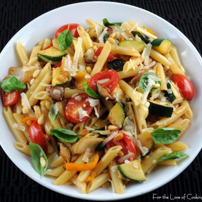 Penne with Mixed Vegetables, Parmesan Cheese, and Pine Nuts