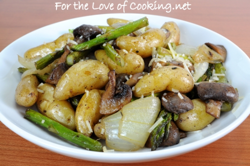 Roasted Baby Potatoes, Mushrooms, Onions, and Asparagus Topped with Parmesan Cheese