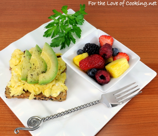 Fluffy Scrambled Eggs and Avocado Slices on Toast