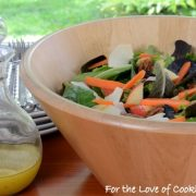 Mixed Greens Salad with Apples, Carrots, Candied Pecans, and Parmesan topped with Maple-Mustard Vinaigrette