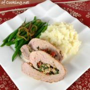 Pork Tenderloin Stuffed with Spinach, Roasted Bell Pepper, Mushroom, and Parmesan