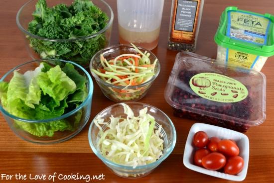 Kale Salad with Tomato, Pomegranate Seeds, and Feta