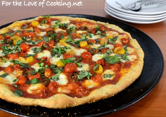 roasted tomato pizza with fresh basil and homemade pizza sauce for