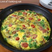 Baked Spanish Tortilla with Potato, Bacon, Onion, Mushroom, Tomato, Spinach, and Sharp Cheddar