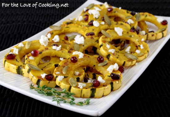 Herb Roasted Delicata Squash Topped With Pomegranate Seeds, Pepitas, and Feta