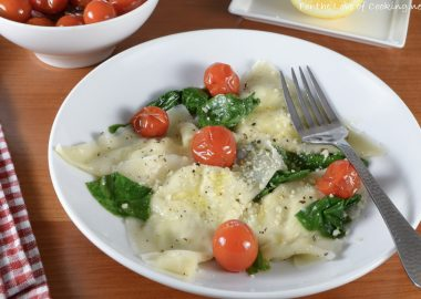 Basil-Ricotta Ravioli with Spinach and Blistered Tomatoes